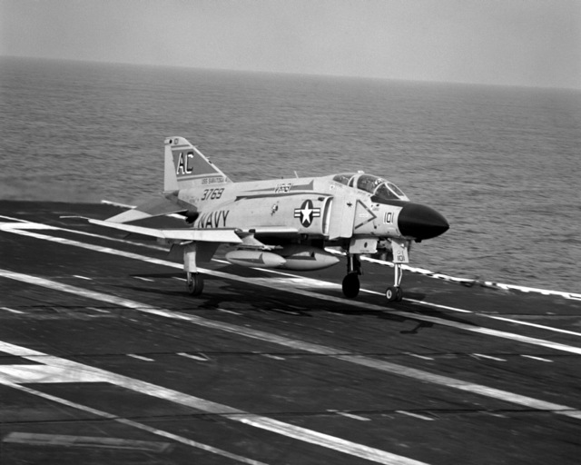 A right front view of an F-4J Phantom II aircraft from Fighter Squadron 31 (VF-31) assigned to Carrier Air Wing 3 (CVW-3) landing aboard the aircraft carrier USS SARATOGA (CV-60) underway off the coast of Florida