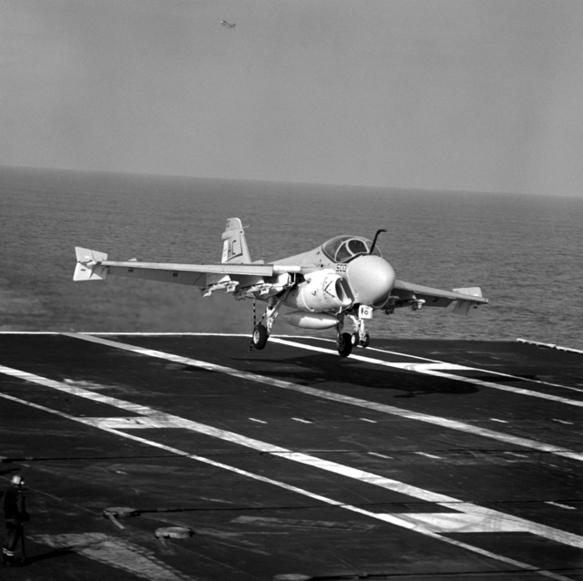Right from view of an A-6E Intruder aircraft from Medium Attack Squadron 75 (VA-75) assigned to Carrier Air Wing 3 (CVW-3) landing aboard the aircraft carrier USS SARATOGA (CV-60) underway off the coast of Florida