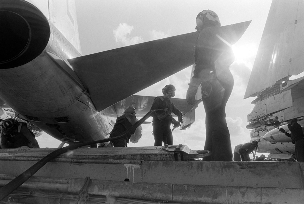 Flight deck crewmen prepare to refuel an A-7 Corsair II aircraft carrier USS KITTY HAWK (CV 63)