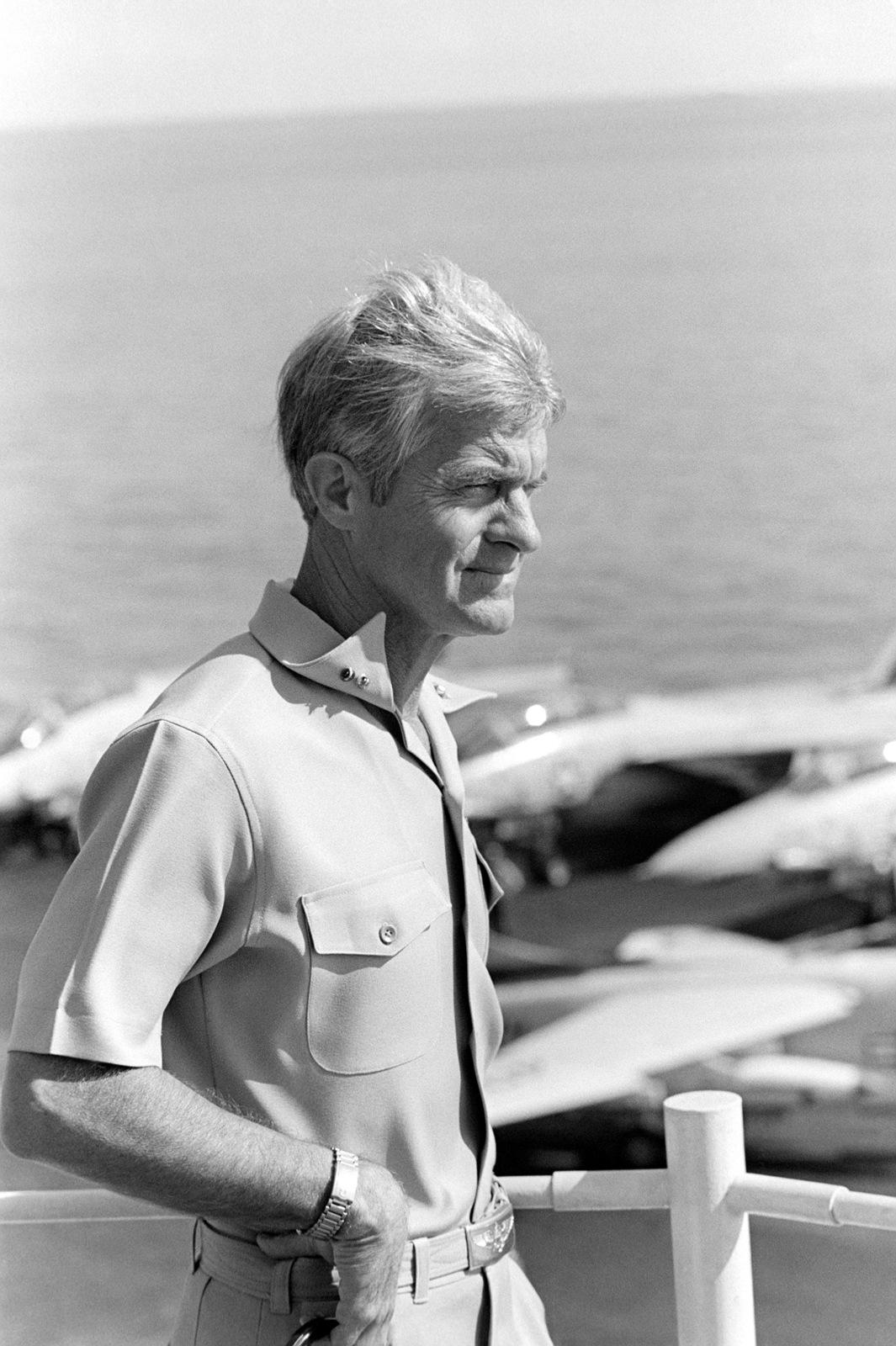 Rear Admiral (RADM) Robert E. Kirksey, commander, Task Force 77, observes flight deck operations from the 0-10 level aboard the aircraft carrier USS KITTY HAWK (CV 63)