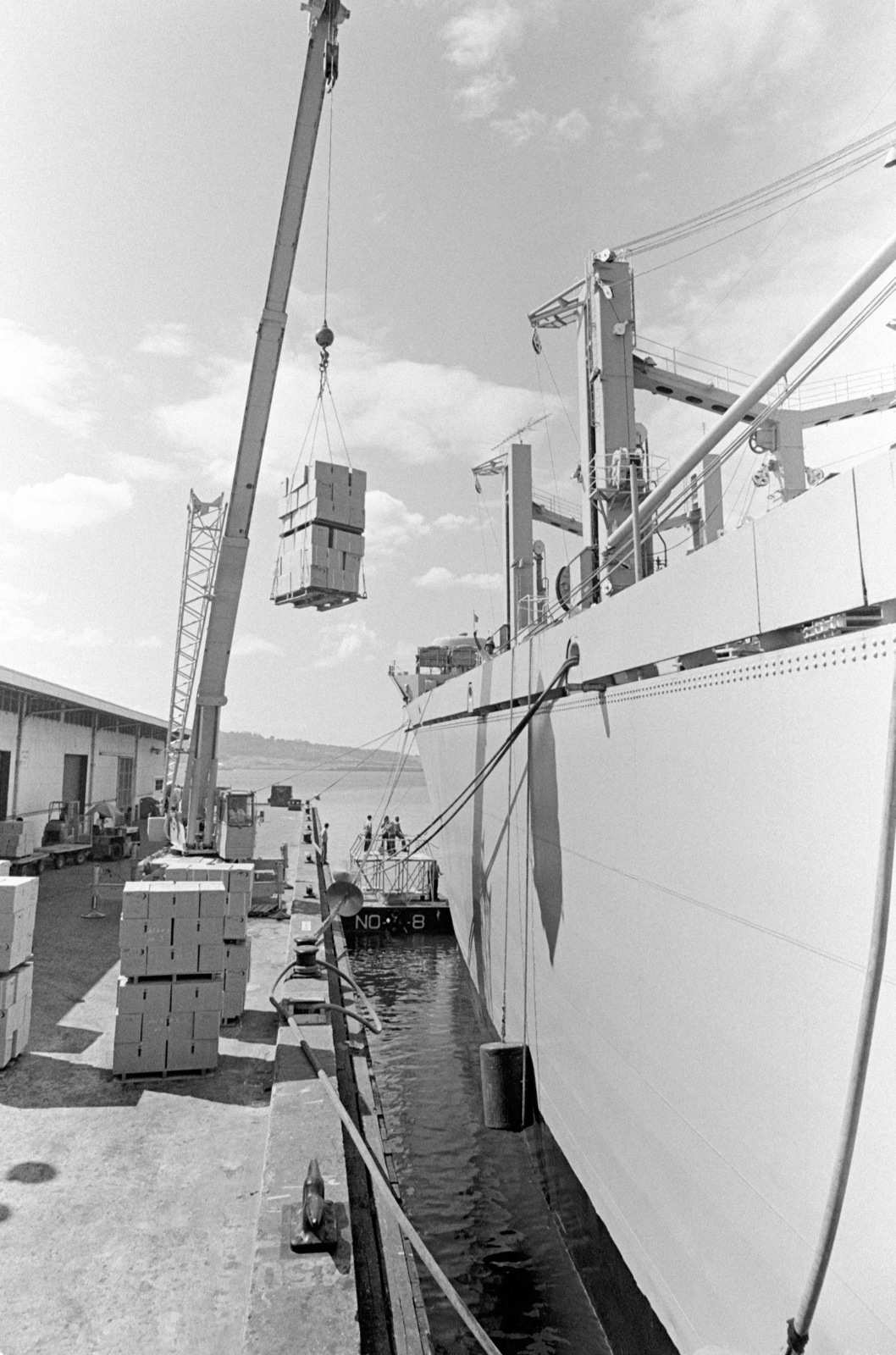 A pier-side crane is used to load supplies aboard the combat stores ship USS SAN JOSE (AFS 7)