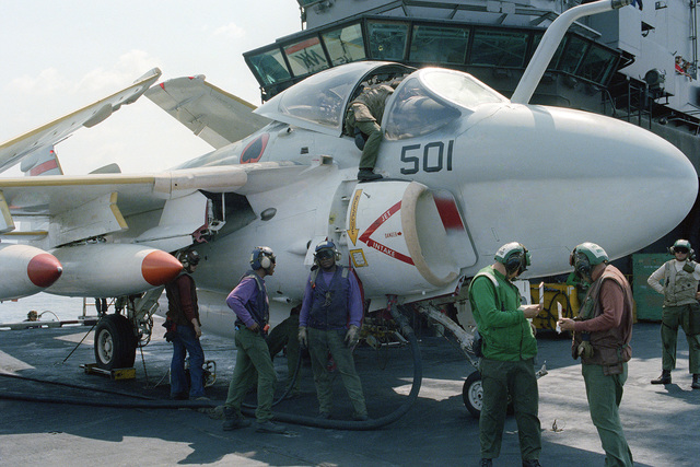 Flight deck personnel refuel an A-6 Intruder attack aircraft aboard the aircraft carrier USS CORAL SEA (CV 43)