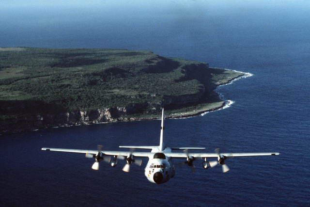 An air-to-air front view of a WC-130 Hercules aircraft in flight over a small Micronesian atoll. The aircraft is assigned to the 54th Weather Reconnaissance Squadron. Bi-monthly Aerospace Audio Visual Service PHOTO Contest, Color Entry, Jul. 1980