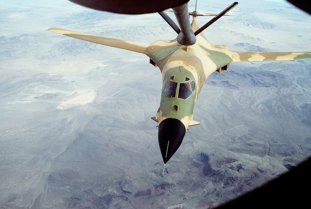 A view from the boom operator's position of a B-1 aircraft, in its new camouflaged paint scheme, being refueled by a KC-135A Stratotanker aircraft