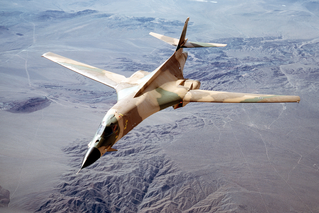 AN air-to-air front view of a B-1 aircraft with its new camouflage paint scheme