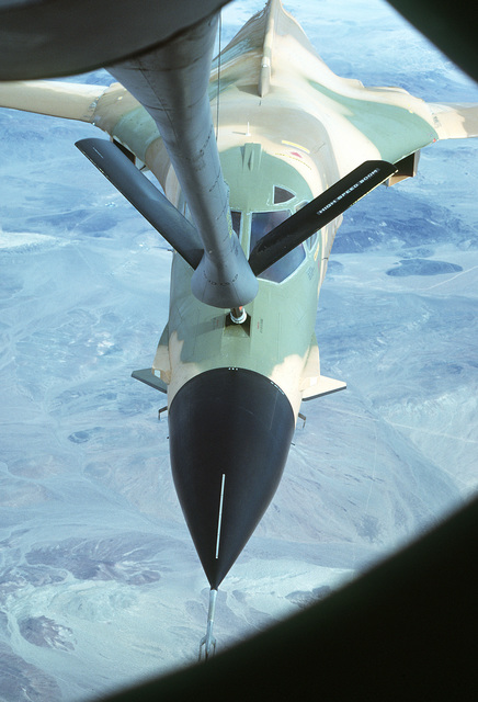 AN air-to-air front view of a B-1 aircraft with its new paint scheme being refueled by a KC-135A Stratotanker aircraft