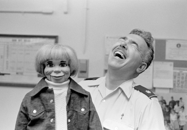 Chaplain LTC William Barr, USAF, with his mannequin named Willie, entertains guests. Bi-monthly Aerospace Audio Visual Service PHOTO Contest, B&W Entry, Jul. 1980