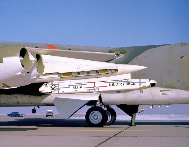Side view of an AGM-86 air-launched cruise missile mounted on a B-52 Stratofortress aircraft wing pylon for an icing test mission