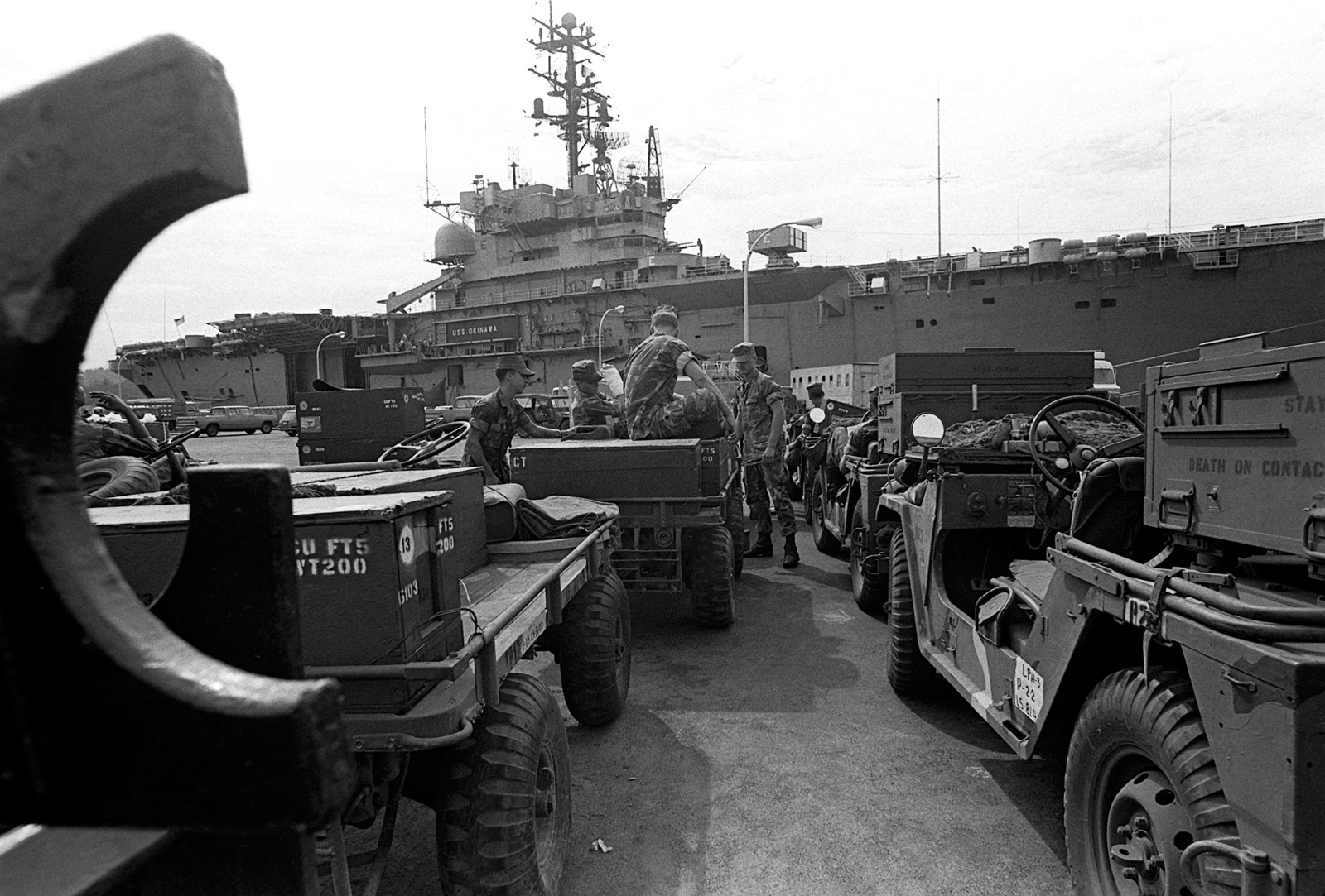 The equipment is staged and the Marines are waiting for the signal to start loading aboard the flagship, USS OKINAWA (LPH-3). The 31st Marine Amphibious Unit is now formed and the Marines are preparing for maneuvers in the Indian Ocean
