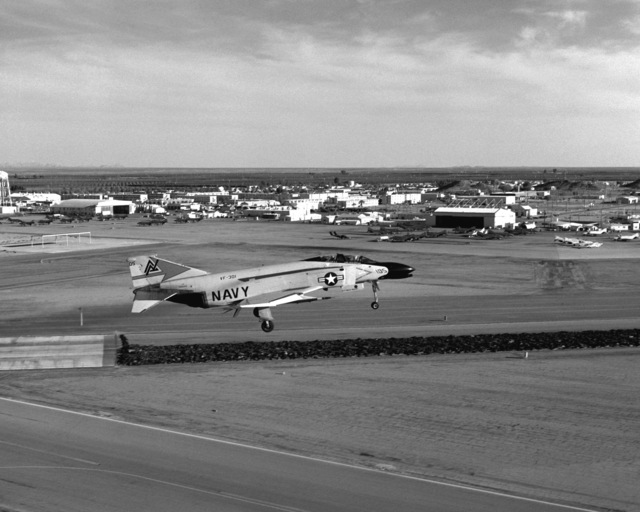 A right side view of an F-4N Phantom II aircraft from Fighter Squadron 301 (VF-301) assigned to Reserve Carrier Air Wing 30 (CVWR-30) preparing to land during the second annual reserve fighter derby