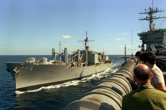 A port bow view of the Mars class combat stores ship USS WHITE PLAINS (AFS-4) underway off the starboard side of the nuclear-powered aircraft carrier USS NIMITZ (CVN-68)