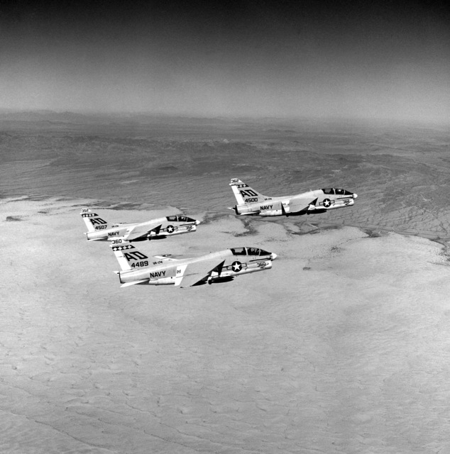 A right side view of three TA-7C Corsair II aircraft from Light Attack Squadron 174 (VA-174) en route to a bombing target during a training mission from Naval Air Facility, El Centro, Calif. The aircraft are carrying Mark 82 bombs
