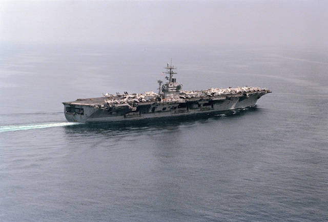 A starboard quarter view of the nuclear-powered aircraft carrier USS NIMITZ (CVN 68) underway