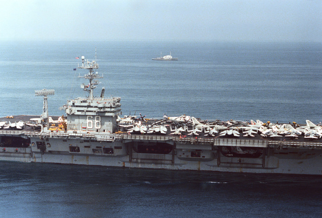 A starboard view of the island structure and amidships section of the nuclear-powered aircraft carrier USS NIMITZ (CVN 68)