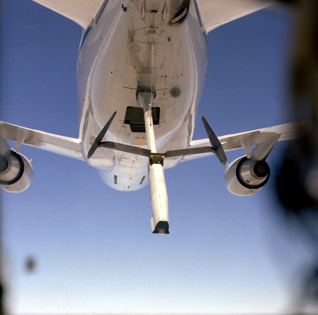 A close-up view of a KC-10A Extender aircraft with a lowered refueling boom, as seen from a C-5A Galaxy aircraft, prior to being hooked up with the Galaxy