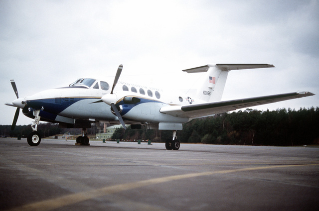 A left front view of a parked C-12 Super King aircraft