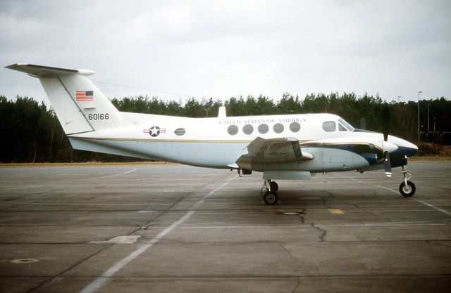 A right side view of a parked C-12 Super King aircraft