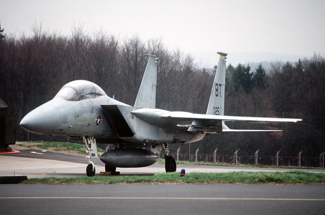 Left front view of an F-15B Eagle aircraft from the 36th Tactical Fighter Wing parked on the flight line