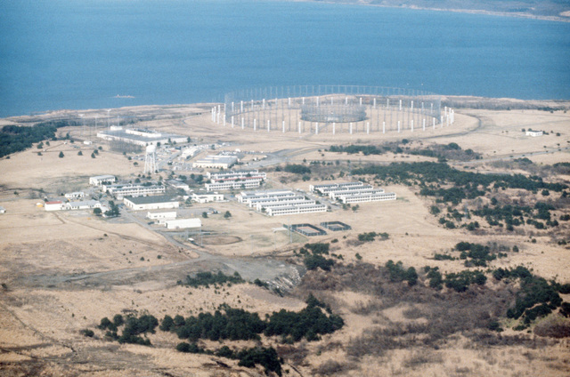 "An aerial view of Security Hill with the""Elephant Cage""AN/FLR-9 circular disposed antenna array in the background"