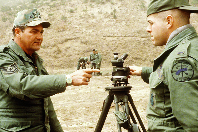 MASTER SGT. Arvel Jackson instructs 1ST LT. Vance Zider on the use of a tripod-mounted mortar sight to ensure the position and alignment of an 81mm mortar and its base plate during heavy weapons training at Rodriquez Range. Jackson is a Pacific Air Force 3rd Security Police Squadron heavy weapons superintendent and Zider, a 51st Security Police Squadron member