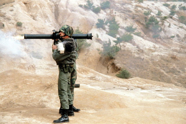 Security policeman SSGT Robert Carrier fires an M-67 90mm recoilless rifle during heavy weapons training at Rodriquez Range