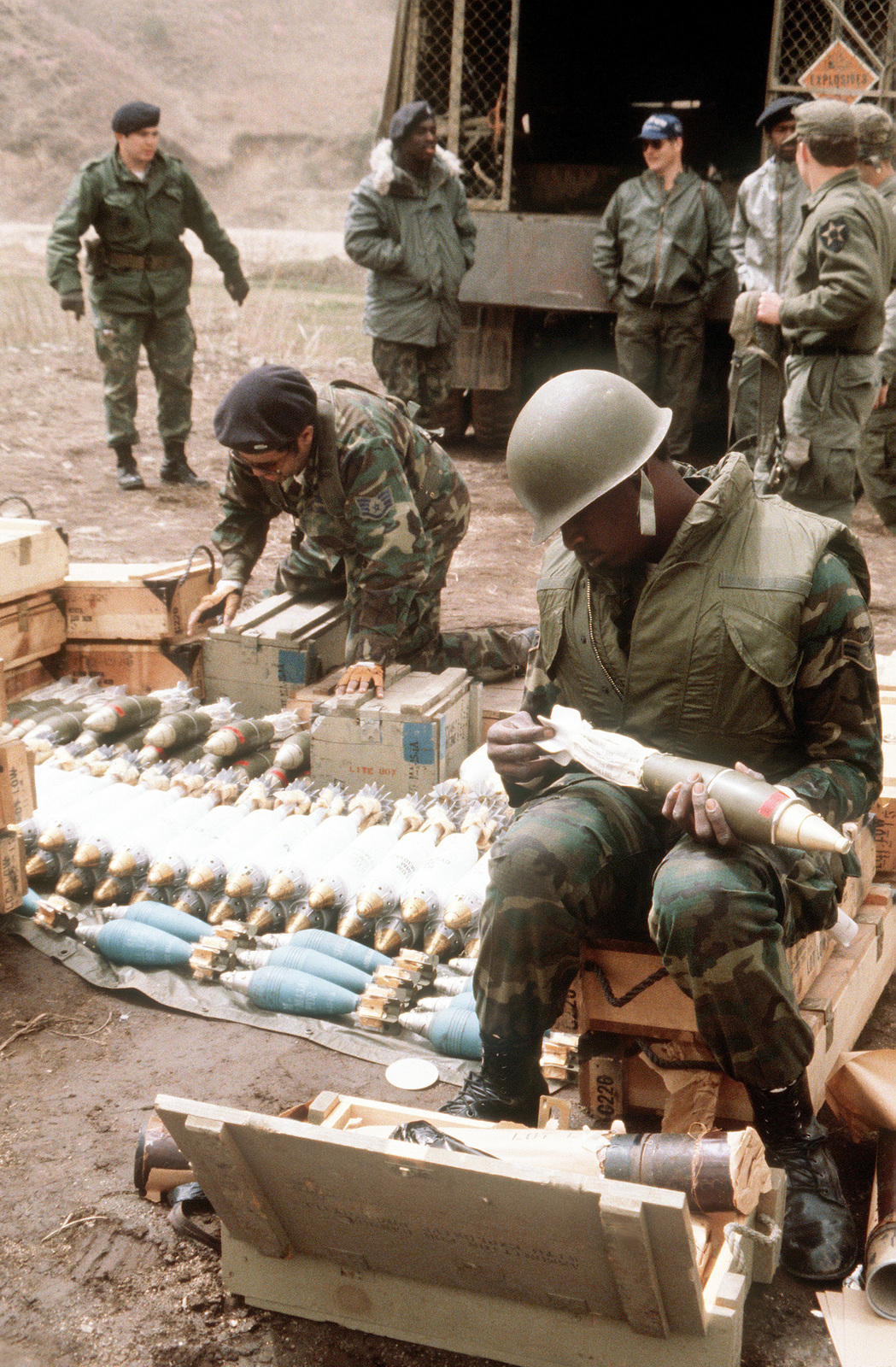 Security policemen set charges on mortar rounds during heavy