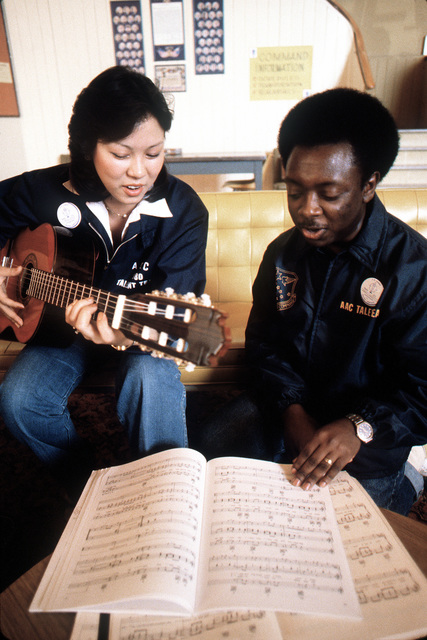 SRA Denise Guyote from Hill Air Force Base, Utah, and SGT Kenneth Lambert from Elmendorf Air Force Base, Alaska, rehearse a song during the Air Force Talent Contest