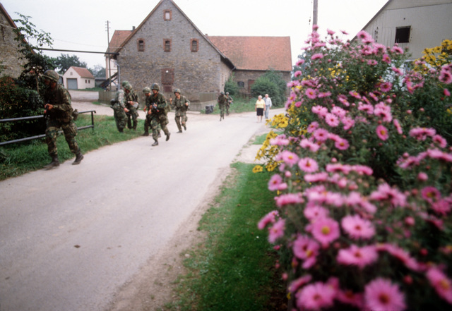 Troops of the 82nd Airborne Division patrol through a German village during exercise REFORGER '80
