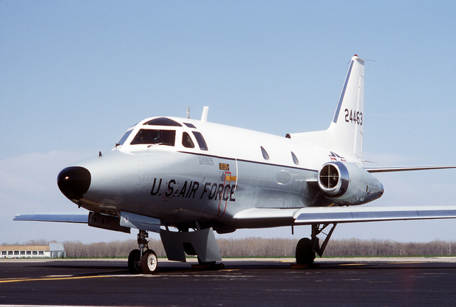 A left front view of a parked T-39 Saberliner aircraft from the 1401st Military Airlift Squadron