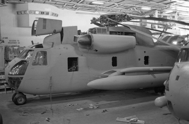 A left side view of an RH-53 Sea Stallion helicopter parked on the flight deck of the nuclear-powered aircraft carrier USS NIMITZ (CVN-68) prior to the start of Operation Evening Light, a rescue mission to Iran
