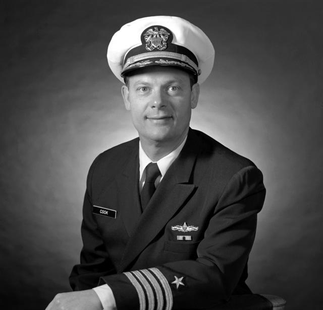 CAPT C. W. Cook Jr., USN (covered)