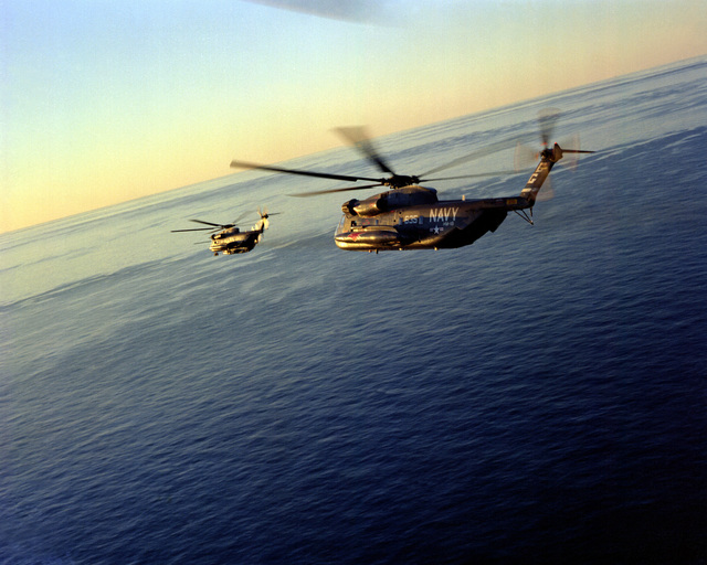 A left side view of two RH-35D Sea Stallion helicopters from Helicopter Mine Countermeasures Squadron 16 (HM-16) in flight