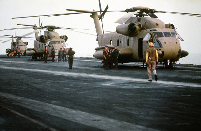 A right side view of three RH-53 Sea Stallion helicopters on the flight deck of the nuclear-powered aircraft carrier USS NIMITZ (CVN-68) prior to the start of Operation Evening Light, a rescue mission to Iran