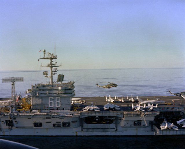 A starboard beam view of the island and forward deck of the nuclear-powered aircraft carrier USS NIMITZ (CVN-68)