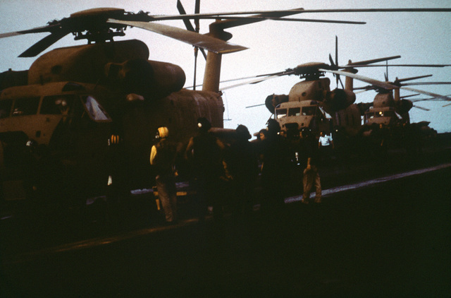 RH-53 Sea Stallion helicopters line the flight deck of the nuclear-powered aircraft carrier USS NIMITZ (CVN-68) prior to the start of Operation Evening Light, a rescue mission to Iran