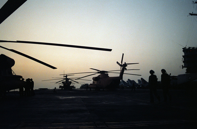 RH-53 Sea Stallion helicopters parked on the flight deck of the nuclear-powered aircraft carrier USS NIMITZ (CVN-68) prior to the start of Operation Evening Light, a rescue mission to Iran