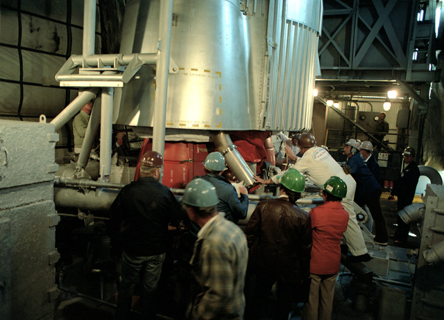 An intercontinental ballistic missile (ICBM) is rotated during assembly