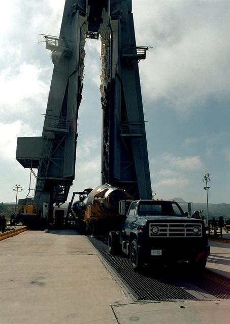 An intercontinental ballistic missile (ICBM) is set on trailer jacks after assembly