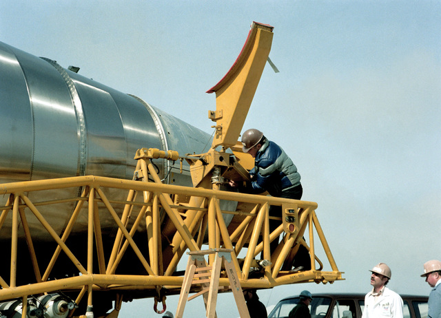 The neck clamps on an intercontinental ballistic missile (ICBM) are removed during assembly