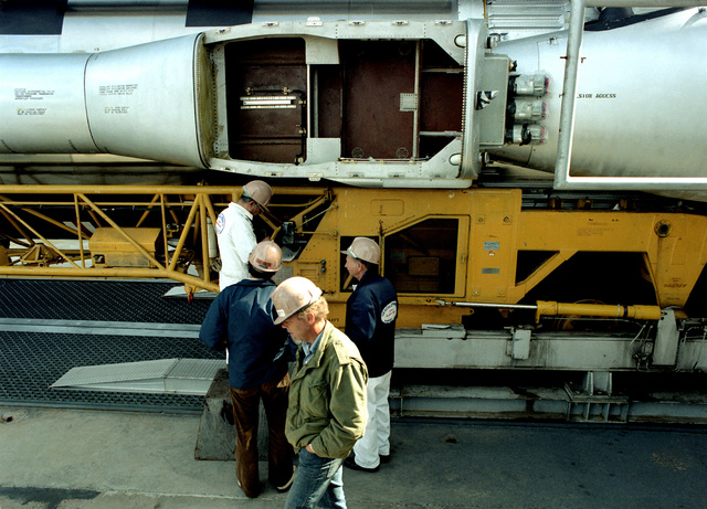 The pods on an intercontinental ballistic missile (ICBM) are inspected during assembly