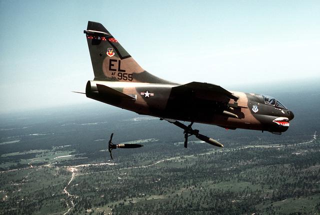 A-7 Corsair II aircraft releasing Mark 82 hi-drag bombs