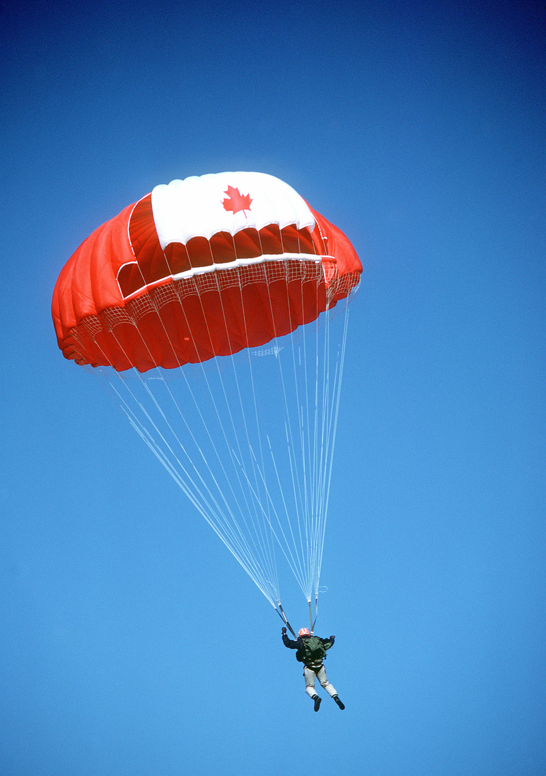 A Canadian jumper floats down during a competitive parachute jump. The man is taking part in Sarex '80, a joint U.S.-Canadian pararescue exercise