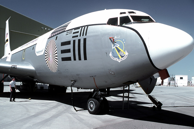 A close-up front view of a parked NKC-135 airborne laser laboratory