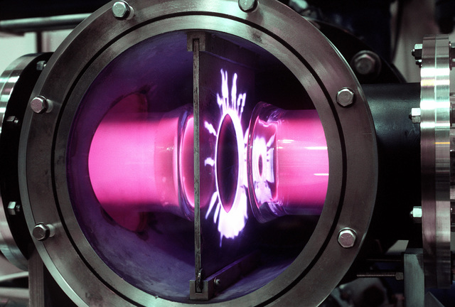 A close-up view of an electric discharge laser beam during an experiment in the laser laboratory of the Air Force Weapons Laboratory. The lasers are used to determine the laser interaction with various types of materials