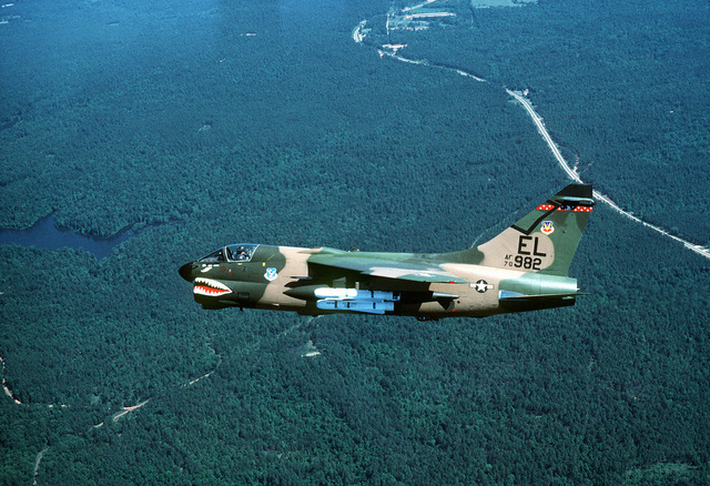 A left side view of an A-7 Corsair II aircraft of the 76th Tactical Fighter Squadron, 23rd Tactical Fighter Wing, carrying four AGM-65A Maverick missiles in-flight over the Tyndall Air Force Base range