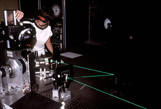 A technician conducts a turbine blade analysis in the holography laboratory of the Compressor Research Facility