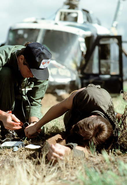 "A ""victim"" is treated by SSGT Ken Suoboda, 1550th Aircrew Training and Test Wing, during Sarex '80, a joint U.S.-Canadian pararescue exercise"