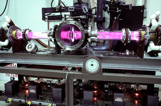 A view of an electric discharge laser device during an experiment in the laser laboratory of the Air Force Weapons Laboratory. The lasers are used to determine the laser interaction with various types of materials