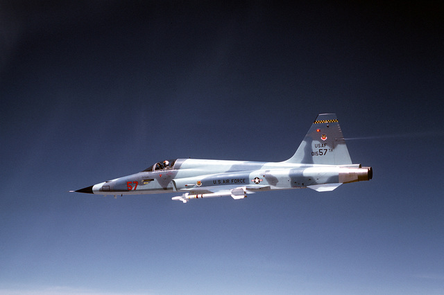 AN air-to-air left side view of an F-5 fighter aircraft of the 57th Weapons Wing