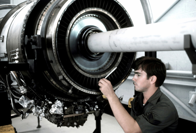 AN airman performs F-15 Eagle aircraft engine maintenance